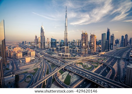 Dubai skyline with beautiful city close to it's busiest highway on traffic - stock photo