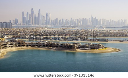 Dubai skyline with Palm Island in the foreground - stock photo