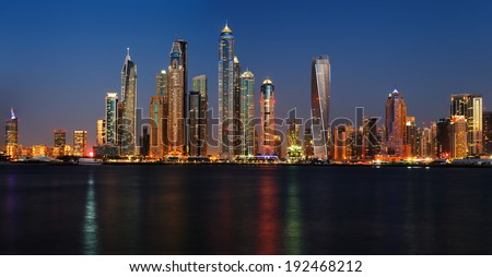 DUBAI, UAE - APR 9: Dubai, UAE. A section of Dubai Marina at dusk as viewed from Palm Jumeirah on Apr 9, 2014 in Dubai, UAE. This part of Dubai has more skyscrapers over 50 stories that Manhattan - stock photo