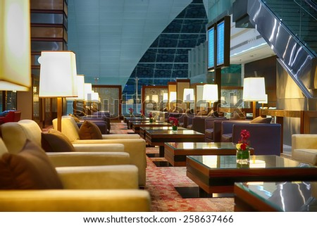 DUBAI, UAE - APRIL 07, 2013: airport interior. Dubai International Airport is a major international airport located in Dubai, and is the world's busiest airport by international passenger traffic. - stock photo