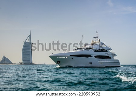 DUBAI, UAE - APRIL 20: Burj Al Arab, built on an artificial island on Jumeirah beach and classed as one of the most luxurious in the world, on April 20, 2014  - stock photo