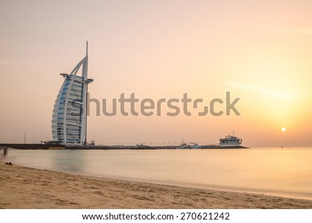 DUBAI, UAE - APRIL 1, 2015 : Burj Al Arab, One of the most famous landmark of United Arab Emirates. Picture taken during sunset on April 1, 2015. - stock photo