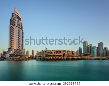 Dubai, UAE, April 29 2015 Dubai Downtown Fountains lake view with Souq Al Bahaar in the Afternoon - stock photo