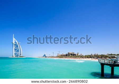 DUBAI, UAE - APRIL 05: The grand sail shaped Burj al Arab Hotel taken April 5, 2015 in Dubai. The hotel is classed as one of the most luxurious in the world and is located on a man made island. - stock photo