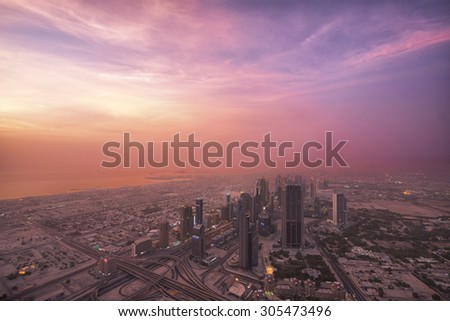 DUBAI, UAE - AUGUST 14: Aerial view of Downtown Dubai and skyscrapers from the tallest building in the world, Burj Khalifa, at 828m. August 14, 2013 Dubai, UAE - stock photo