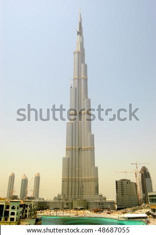 DUBAI, UAE - AUGUST 27: The Burj Khalifa (Burj Dubai) during sunset. It is world's tallest skyscraper (height 828m, 160 floors), seen on August 27, 2009 in Dubai, United Arab Emirates - stock photo