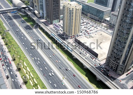 DUBAI, UAE - AUGUST 13: View of Sheikh Zayed Road. The highway runs parallel to the coastline to the border with Abu Dhabi. It is home to most of Dubai skyscrapers. August 13, 2013 Dubai, UAE - stock photo