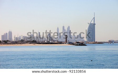 DUBAI, UAE - DEC 23: Burj Al Arab, a luxury hotel in Dubai, United Arab Emirates, on December 23, 2011. It stands on an artificial island out from Jumeirah beach and is shaped as the sail of a ship. - stock photo