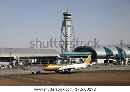 DUBAI, UAE - DEC 30: Gulf Air airplane at the Dubai International Airport. December 30 2013 in Dubai, United Arab Emirates - stock photo