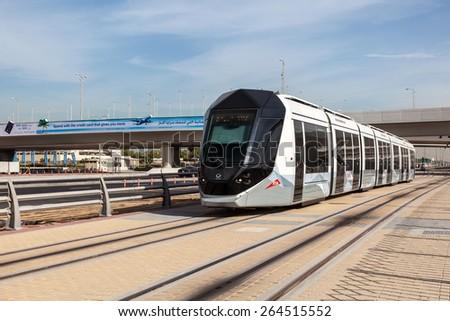 DUBAI, UAE - DEC 16: New tram service in the city of Dubai. December 16, 2014 in Dubai, United Arab Emirates - stock photo