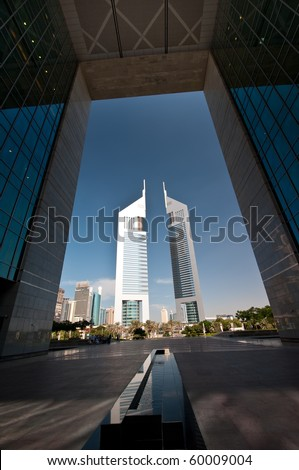 DUBAI, UAE - DEC 04: The iconic Emirates Towers of Dubai taken on 4th December 2009.  One of the two towers is a hotel and the other is an office building with a Boulevard of shops and restaurants. - stock photo