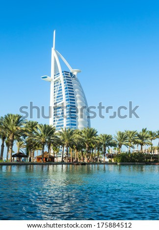 """DUBAI, UAE - December, 10, 2013: A general view of the world's first seven stars luxury hotel Burj Al Arab """"Tower of the Arabs"""", also known as """"Arab Sail"""" - stock photo"""
