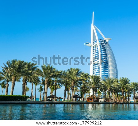 "DUBAI, UAE - December, 10, 2013: A general view of the world's first seven stars luxury hotel Burj Al Arab ""Tower of the Arabs"", also known as ""Arab Sail"" - stock photo"
