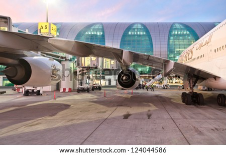 DUBAI, UAE - DECEMBER 26: Emirates Airbus A380 at Dubai Airport on December 26, 2012 in Dubai, UAE. Emirates handles major part of passenger traffic and aircraft movements at the airport. - stock photo