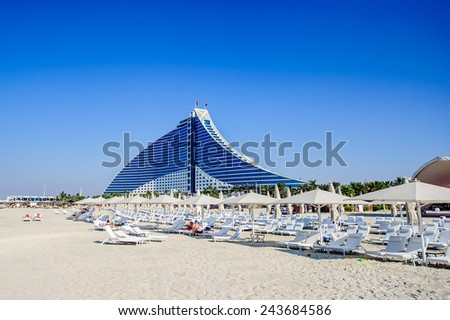 DUBAI, UAE - DECEMBER 25: Jumeirah Beach Hotel on December 25, 2014 in Dubai. This wave-shaped hotel complements the sail-shaped Burj Al Arab, which is adjacent to the Jumeirah Beach Hotel