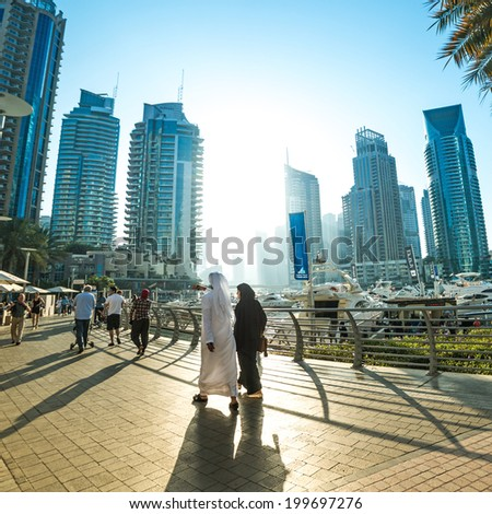 DUBAI, UAE - DECEMBER 14: Modern buildings in Dubai Marina, Dubai, UAE. In the city of artificial channel length of 3 kilometers along the Persian Gulf, taken on 14 December 2013 in Dubai. - stock photo