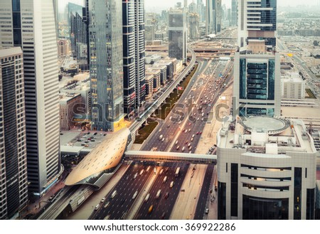 DUBAI, UAE - DECEMBER 16, 2015: Rooftop view of Sheikh Zayed road with traffic and skyscrapers. This is one of the iconic views of Dubai. - stock photo