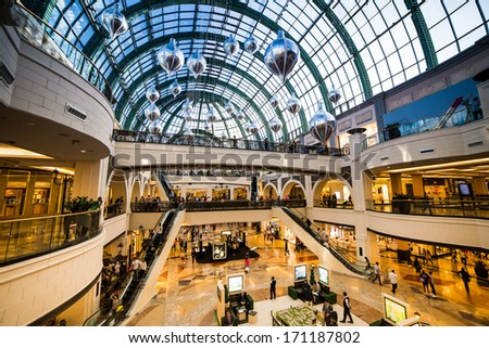 DUBAI, UAE - DECEMBER 19: Shoppers at Mall of the Emirates on December 19, 2013 in Dubai. Mall of the Emirates is a shopping mall before christmas in the Al Barsha district of Dubai. - stock photo