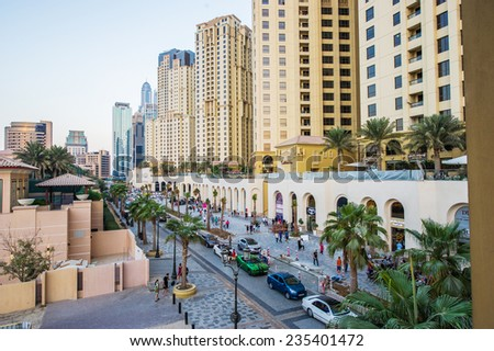 DUBAI, UAE - DECEMBER 02, 2014 : View of modern skyscrapers in Jumeirah beach residence on December 02, 2014 in Dubai, JBR - artificial canal city, carved along a 3 km on Persian Gulf shoreline. - stock photo