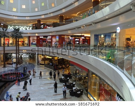 DUBAI, UAE - FEB 13: Al Ghurair City Shopping Mall in Dubai, UAE, as seen on Feb 13, 2014. It is one of Dubais oldest shopping centres and was recently renovated and expanded. - stock photo