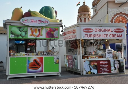 DUBAI, UAE - FEB 12: Food and drink stalls at Global Village in Dubai, UAE, as seen on Feb 12, 2014. The Global Village is claimed to be the world's largest tourism, leisure and entertainment project. - stock photo