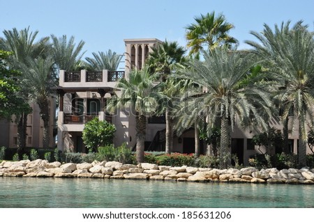 DUBAI, UAE - FEB 17: Madinat Jumeirah Arabian Resort in Dubai, UAE, as seen on Feb 17, 2014. It is the largest resort in Dubai, spreading across 40 hectares of landscapes and gardens. - stock photo