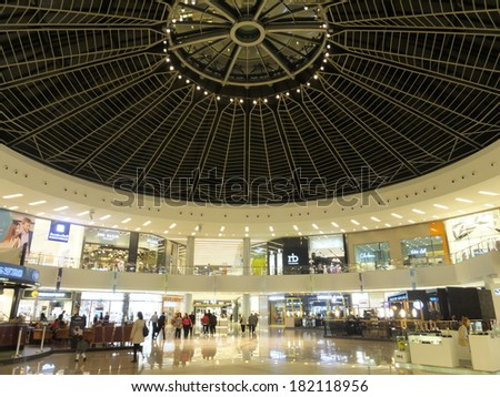 DUBAI, UAE - FEB 19: Marina Mall in Dubai, UAE, as seen on Feb 19, 2014. The mall features 140 retail outlets, spread over 390,000 sq ft of space, making it one of the largest shopping malls in Dubai. - stock photo