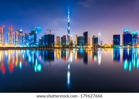 DUBAI, UAE - FEB 08: Skyline view of Dubai showing the Burj Khalifa and other skyscrapers of business bay on Feb 08, 2014 in Dubai, UAE. The Burj Khalifa, the tallest skyscraper in the world at 829.8m - stock photo