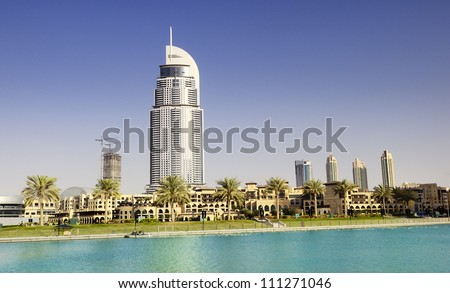 DUBAI, UAE - FEB 02: The Address Hotel in the downtown Dubai area overlooks the famous dancing fountains, taken on February 2, 2012 in Dubai, UAE. The hotel is surrounded by a mall, hotels and Burj Khalifa - stock photo