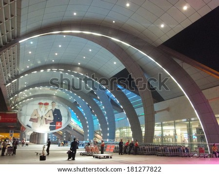DUBAI, UAE - FEB 1: The newer Terminal 3 (Emirates) at Dubai International Airport, one of the busiest airports, on Feb 1, 2014. It is the single largest building in the world by floor space.  - stock photo