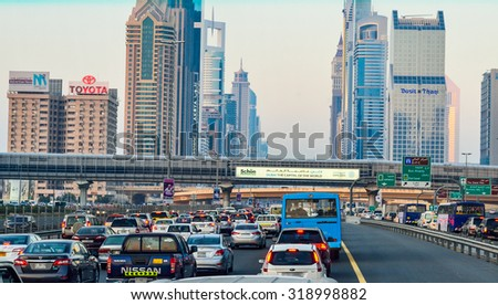 DUBAI, UAE - FEB 27 2014: Traffic Jam at Sheikh Zayed Road in Dubai. Thursday and Friday nights are the busiest in Dubai as it is the last day of the work week and its also the weekend for most people - stock photo