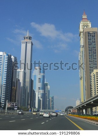 DUBAI, UAE - FEB 20: View of Sheikh Zayed Road skyscrapers in Dubai, UAE on Feb 20, 2014. The Sheikh Zayed Road (E11 highway) is home to most of Dubai's skyscrapers, including the Emirates Towers. - stock photo