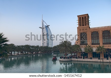 DUBAI, UAE - FEBRUARY 20, 2010: Burj Al Arab viewed from the Madinat Jumeirah, overlooking the water taxi routes. The hotel is classed as one of the most luxurious in the world.