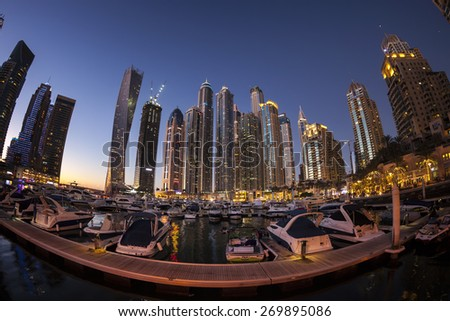 DUBAI, UAE - FEBRUARY 28:  Dubai Marina at dusk. Dubai Marina is an artificial canal city, built along a 3 km stretch of Persian Gulf shoreline. Picture taken on February 28, 2015. - stock photo