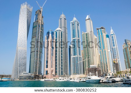 DUBAI, UAE - FEBRUARY 11, 2016: Dubai Marina in the famous marina district in Dubai with modern skyscrapers, residential towers. Dubai is one of the fastest developing city in the world - stock photo