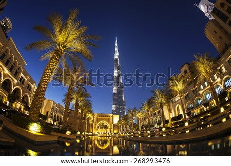DUBAI, UAE - FEBRUARY 24 - Evening view of downtown Dubai with Burj Khalifa in the background, the tallest building in the world, 829.8 m tall. Picture taken on February 24, 2015. - stock photo