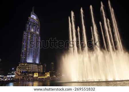 DUBAI, UAE - FEBRUARY 25: The Dubai Fountain is the world's largest choreographed fountain system set on the 30-acre manmade Burj Khalifa Lake. Picture taken on February 25, 2015 - stock photo
