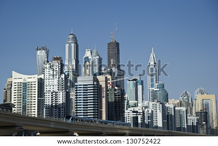 DUBAI, UAE - FEBRUARY 22: View of modern skyscrapers in Dubai Marina on February 22, 2013 in Dubai, UAE. Dubai Marina - artificial canal city, carved along a 3 km stretch of Persian Gulf shoreline.