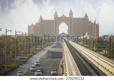 DUBAI, UAE - FEBRUARY 27, 2015: View of the Atlantis hotel from a monorail train connecting the Palm Jumeirah to the mainland. Atlantis, The Palm is a majestic 5 star luxury hotel. February 27, 2015. - stock photo