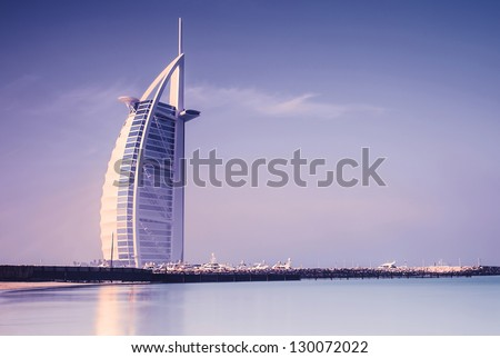 DUBAI, UAE - JAN 28: Burj Al Arab is 321m, second tallest hotel in the world, luxury hotel stands on an artificial island, January 28,2013 Jumeirah beach, Dubai, United Arab Emirates - stock photo