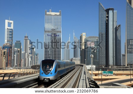 DUBAI, UAE - JAN 15: Metro train downtown in Dubai City. January 15, 2012 in Dubai, United Arab Emirates  - stock photo