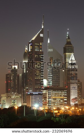 DUBAI, UAE - JAN 18: Skyscrapers in Dubai downtown illuminated at night. January 18, 2012 in Dubai, United Arab Emirates