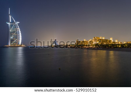 DUBAI,UAE-JAN 22: The glow of the burj al arab at night on the 22th of january 2010, in Dubai,Uae.The Burj is the most exclusive hotel of the world.