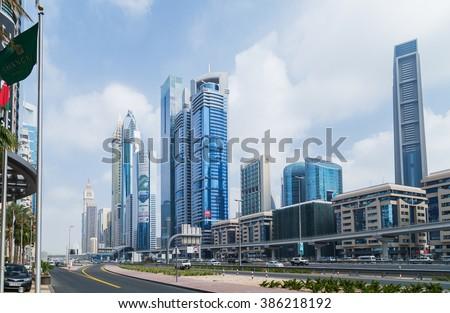DUBAI, UAE - JANUARY 26: Architecture of Dubai many highrise buildings. Dubai with many traditional arabic shops and street market. Dubai, UAE circa January 2016 - stock photo