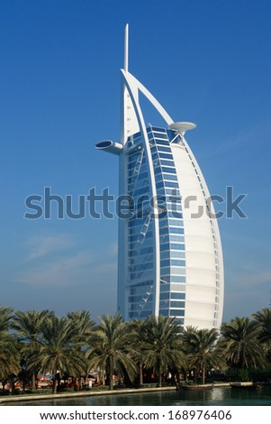 DUBAI, UAE - JANUARY 19, 2010: Burj Al Arab Hotel.  Burj Al Arab is a luxury 5 stars hotel built on an artificial island in front of Jumeirah beach and prominent attraction point of Dubai. - stock photo