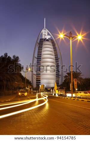 DUBAI, UAE - January 3: Burj Al Arab hotel on Jan 3, 2012 in Dubai. Burj Al Arab is a luxury 5 stars hotel built on an artificial island in front of Jumeirah beach. Sunset View - stock photo