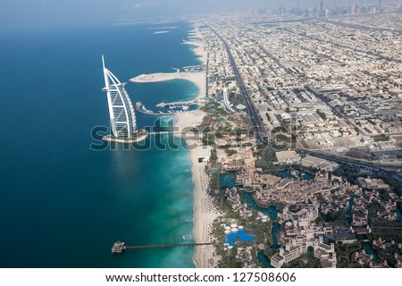 DUBAI, UAE - JANUARY 20: Burj Al Arab hotel on January 20, 2011 in Dubai, UAE. Burj Al Arab is a luxury 5 star hotel built on an artificial island in front of Jumeirah beach - stock photo