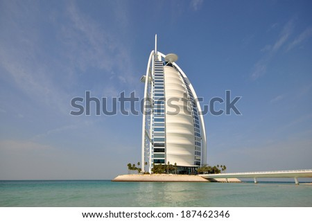 DUBAI, UAE - JANUARY 9, 2013: Burj Al Arab in Dubai, as seen on January 9, 2013. It is a 7-star hotel built on an artificial island and is the fourth tallest hotel in the world. - stock photo