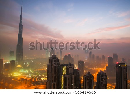 DUBAI, UAE - JANUARY 23, 2016: Burj khalifa, the highest building in the world, Downtown is covered by early morning fog on January,23 2016 in Dubai, United Arab Emirates