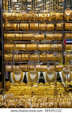 "DUBAI, UAE - JANUARY 31: Gold on the famous ""Golden souk"" in Dubai Deira market on 31 January 2016, UAE. Deira is an old commercial center of Dubai with the biggest street market."